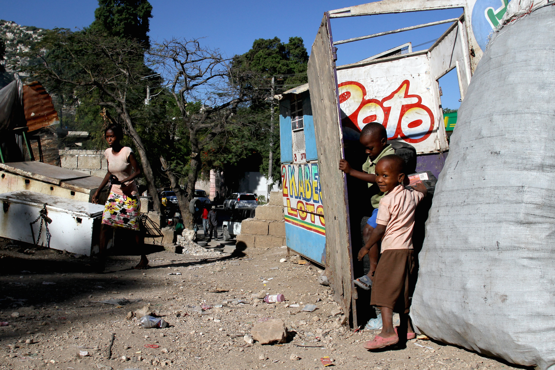 Children play in a discarded lottery booth in the Acra 2 camp, located in the Pétion-Ville commune of Port-au-Prince.